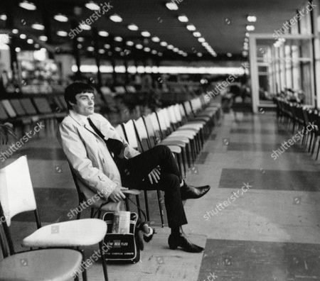 Drummer Jimmy Nicol, who had been stand-in for tonsillitis stricken Beatle Ringo Starr, is alone and contemplative at Melbourne's Essendon Airport, in Australia,, while waiting to return home. Ringo rejoined the Beatles the day before