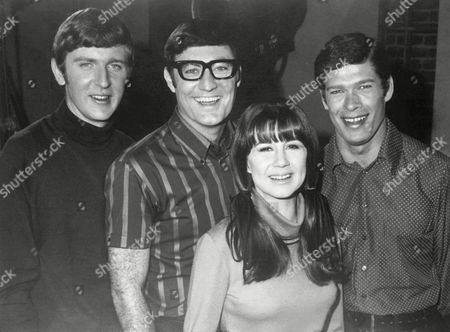 The Australian singing group 'The Seekers', pose for photographers, in Sydney, . From left to right; Bruce Woodley, Athol Guy, Judy Durham and Keith Potger