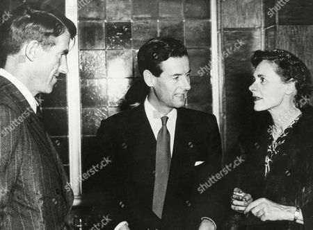 L-R: Sir Edmund Hillary; Group Captain Townsend, British Air Attache in Brussels; and actress Celia Johnston at a reception held by Le Soir newspaper who are sponsoring a charity screening of Alexander Korda films in Brussels, Belgium on . Hillary was the guest of honor