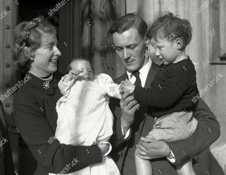 Anthony Wedgwood Benn holds his son Stephen Michael, outside the House of Commons, London, . His American-born wife Caroline holds their son Hilary James, after his christening in the crypt of the House of Commons