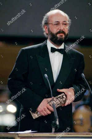 "French film director Bertrand Blier expresses his thanks while holding his Cesar's after being awarded 1989 French best film director for his film ""Trop belle pour toi"" (Too Good for You) during the 15th Cesars Industry award ceremony, Sunday night, in Paris"