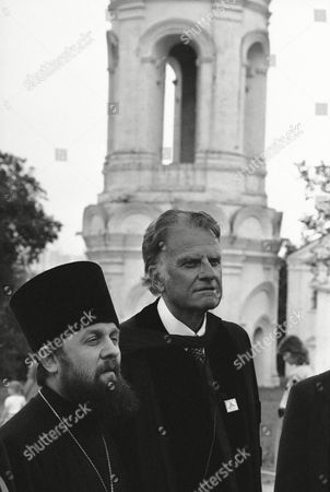 Billy Graham, Vladimir Sorokin American Evangelist Billy Graham, right, walks with Vladimir Sorokin in front of the steeple of Kolomenskoye church in Moscow after the Evangelist held a preaching hour that was translated into Russian by Sorokin, who is head of Russian Orthodox Seminary in Leningrad