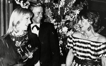 Bjorn Borg, Mariana Simionescu Borg, Chris Evert Number one U.S. tennis champ Chris Evert Lloyd, left, Swedish ace Bjorn Borg and his wife Mariana share a laugh, in a famous restaurant in the Bois de Boulogne, Paris, during an evening of the two tennis champions being awarded world champion trophies