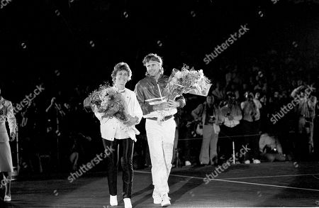 Bjorn Borg, Mariana Simionescu Holding farewell bouquets, Sweden's Bjorn Borg and his wife Mariana, smile at cheering Japanese fans as they leave the court after Borg played his last career tennis match in Tokyo on . Borg lost to his long-time foe Jimmy Connors in the finals of the $250,000 Suntory Cup Tennis Championship, 6-3, 6-4