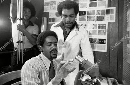 Bobby Seale, seated, with one of the workers in the Panthers? free clinic on