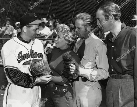 Boudreau Winters Duryea Stewart Cleveland Indians manager Lou Boudreau, left, is visited by actress Shelley Winters, Dan Duryea and Jimmy Stewart, far right, in Tuscon, Ariz, where the actors are filming on location