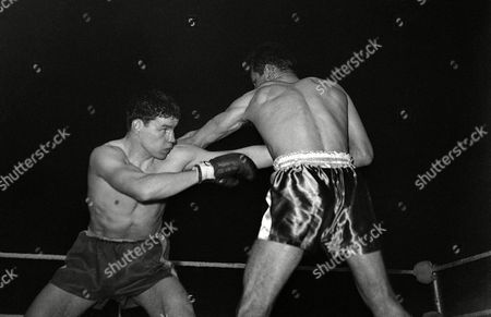 Terry Downes the middleweight champion of Britain, left, slips a left from Willie Green of New England, USA, during their contest at Empire Pool, Wembley, London, on . Downes won when the referee stopped the fight in the third round of a scheduled ten round bout