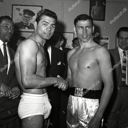 British middleweight champion Terry Downes, right, and Wild Willie Green from Warwick, Rhode Island, shake hands at their weight-in at Joe Bloom's Gymnasium, in London, on . They meet over ten rounds at London's Wembley Pool that night