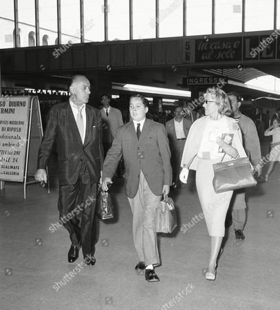 French-born Hollywood actor Charles Boyer, his son Mike and his wife, Pat Paterson arrive at the Rome Railway Station from Paris, en route to the Isle of Ischia where they will stay for a vacation