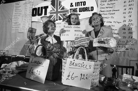 Social Services secretary, Mrs Barbara Castle, left, her seven year old great-niece Rachel Hilton and Mrs Joan Marten, wife of Neil Martin, Chairman of the anti-Common Marketeers (unseen) display goods they brought in London and Brussels with their retrospective prices for comparison during a press conference at the Waldorf Hotel in London, England on . Mrs. Castle is one of the Labour Party's anti-marketeers