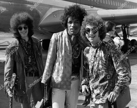 Bass guitarist Noel Redding, left, guitarist Jimi Hendrix, center, and drummer Mitch Mitchell, of the Jimi Hendrix Experience, at Heathrow airport in London. The apartment where rock guitarist Jimi Hendrix lived and died in London will be open to the public starting 2016. He lived at 23 Brook Street in London's posh Mayfair section, adjacent to the home where composer George Frideric Handel had lived two centuries earlier
