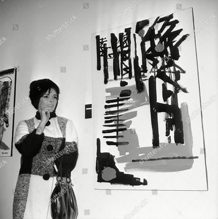 """British actress-painter British actress-painter Barbara Steele stands by one of ten of her paintings displayed at a personal show of her works in a downtown Rome art gallery on . She has called the painting """"Fellini 8½, after the tentative title of a recent film in which she is starring and which is directed by Italy's Federico Fellini"""