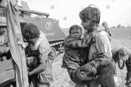 Norman Lloyd A CBS cameraman, Norman Lloyd, right, carries a Cambodian soldier to an aid station after a mortar barrage south of Phnom Penh, Cambodia, wounded government troops and six newsmen. Lloyd, of New South Wales, Australia, was among those injured in the April 22 action