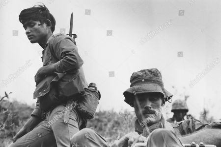 Sean Flynn, right, American freelance photojournalist covering the war in Southeast Asia for Time Magazine, is seen during operations near Ha Thanh, some 325 miles from Saigon, in South Vietnam. Forensic tests will be conducted on what two searchers believe are the remains of photographer Sean Flynn, son of Hollywood star Errol Flynn, who disappeared during the Cambodian War 40 years ago, the U.S. Embassy said . On the left is a Montagnard mercenary, a native hill tribesman fighting in alliance with the U.S. Special Forces. Flynn and the photographer of this picture, Dana Stone, went missing on April 6, 1970, in the Svay Rieng province of Eastern Cambodia, reportedly being captured by Viet Cong forces based in Cambodia