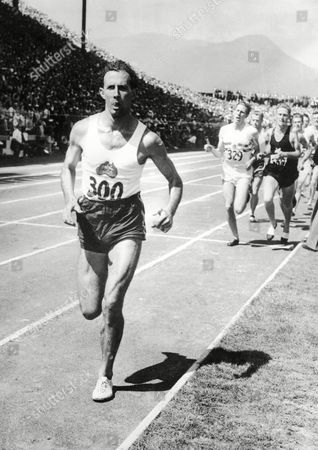 John Landy of Australia leads the field at the end of the first lap of the mile race during the Empire Games, now known as the Commonwealth Games, in Vancouver, Canada, on . The race was won by Roger Bannister of England, no.329, in 3.58.8 and Landy came second in 3.59.6, to make this the first mile race in history in which two runners have crossed the finish line in under four minutes