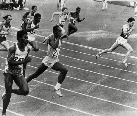 Alan Wells of Scotland, right, heads for the finish line and the Gold medal in the men's 200metres final at the Commonwealth Stadium, during the 11th Commonwealth games in Edmonton, Canada, on . James Gilkes of Guyana, second left, won the Silver medal and Colin Bradford of Jamaica, left, won the Bronze medal