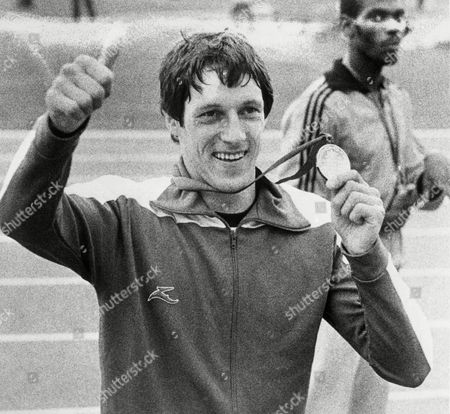 Alan Wells of Scotland with the Gold medal which he had won in the final of the men's 200metres in the Commonwealth Stadium, during the 11th Commonwealth Games at Edmonton, Canada, on