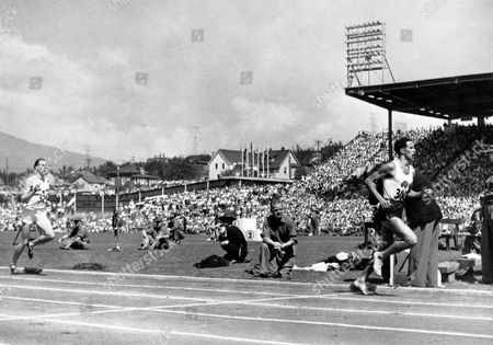 John Landy of Australia, right, leads Roger Bannister of England at the half-way mark during the one mile race at the Empire Games, now known as the Commonwealth Games, in Vancouver, Canada, on . Bannister overtook Landy in the final 100 yards of the race, beating him by three yards