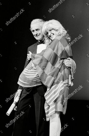 """Antonioni Vitti Italian director Michelangelo Antonioni is embraced by actress Monica Vitti after receiving the Special 35th Anniversary Award for his film """"Identification of a Woman"""" at Cannes International Film Festival in France"""