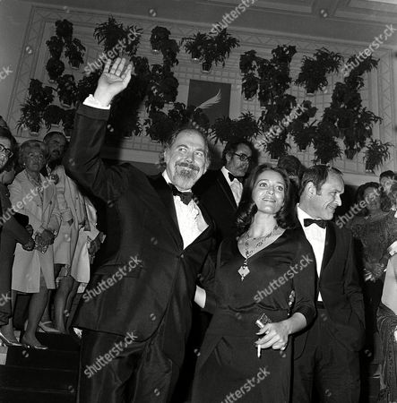 Altman Fabian Bozzufi American film director Robert Altman, waving, French actress Francoise Fabian and actor Marcel Bozzuffi arrive at Festival Palace for the Cannes International Film Festival in Cannes, France