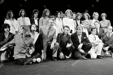 """Actors from late film director Francois Truffaut's films pay tribute to him prior to the showing of """"Vivement Truffaut,"""" at Cannes, France, . From left to right: Jeanne Moreau, Fanny Ardent, Chantal Mercier, Dani Graule, Jacqueline Bisset, Catherine Deneuve, Gerard Depardieu, Charles Aznavour, Jean Claude Brisly, Jean-Pierre Aumont, Delphine Seyrig, Brigitte Fossey, and Jean-Pierre Leaud"""