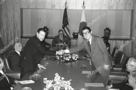 Caspar Weinberger, Shintaro Abe Defense Secretary Caspar Weinberger, left, and Japan?s Foreign Minister Shintaro Abe shake hands over the table before they sit down to do their business at Tokyo?s Foreign Ministry in Tokyo on . U.S. Ambassador to Japan Mike Mansfield sits at extreme left. Weinberger arrived on Thursday for a four-day visit to Japan