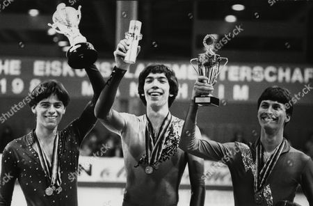 West German figure skaters present their trophies after the men's event of the West German Championships, in Mannheim, West Germany, . Posing from left to right are: Rudi Cerne, 2nd, Heiko Fischer, 1st and Norbert Schramm 3rd