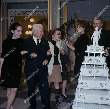 """Charlie Chaplin, Charles Chaplin, Sophia Loren, Victoria Chaplin, Josephine Chaplin, Sydney Chaplin, Oona O'Neill Chaplin Flanked by two of his daughters, Josephine, left, and Victoria, right, veteran actor Charlie Chaplin is pictured during a surprise pre-birthday party on the set of the picture """"A Countess from Hong Kong,"""" at Pinewood Studios in Buckinghamshire, . At right is Italian actress Sophia Loren and Sydney Chaplin, son of Charlie from a previous marriage, far right. Oona Chaplin is partially obscured behind daughter Victoria"""