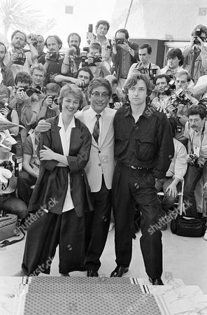 """Charlotte Rampling, Anthony Higgins, Nagisa Oshima Japanese film director Nagisa Oshima, center, whose film """"Max My Love"""" is in competition during the 39th Cannes Film Festival in Cannes, France on . Left is British actress Charlotte Rampling and right is British actor Anthony Higgins"""