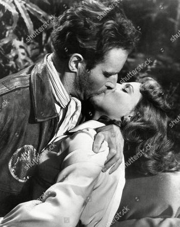"Charlton Heston Charlton Heston in a scene from ""Secret of the Incas"" with Nicole Maurey on"
