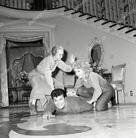 """From left to right, actors Irene Ryan as Granny, Max Baer, Jr. as Jethro, and Donna Douglas as Elly May, are shown on the set of the television series """"The Beverly Hillbillies,"""" in Los Angeles"""
