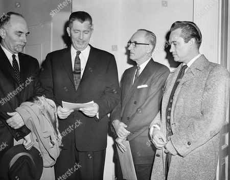 Stock Image of Officials from Mississippi and Alabama pose outside hearing room of House Judiciary Committee before testifying on civil rights legislation. In group, from left, are Senator Sam Engelhardt of Alabama, Mississippi Governor Jams Coleman, Mississippi Attorney General Joseph Patterson and Judge George Wallace of Clayton, Alabama