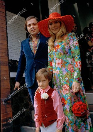 Stock Image of Cynthia Lennon, Cynthia Powell, Julian Lennon, Roberto Bassanini Cynthia Lennon, former wife of John Lennon, is pictured with Italian hotelier Roberto Bassanini, and her son Julian, 8, as they leave Kensington, London registry office after their wedding, . Cynthia, whose marriage to Lennon was dissolved in 1968, wears an ankle length floral patterned dress and red floppy hat