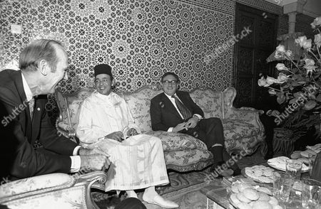 David Newsom, Henry Kissinger, King Hassan David D. Newsom, U.S. under secretary of state for African affairs, King Hassan of Morocco and U.S. Secretary of State Henry A. Kissinger chat before lunch at the Royal Palace at the end of his short stop on his way to the Middle and Far East in Rabat on