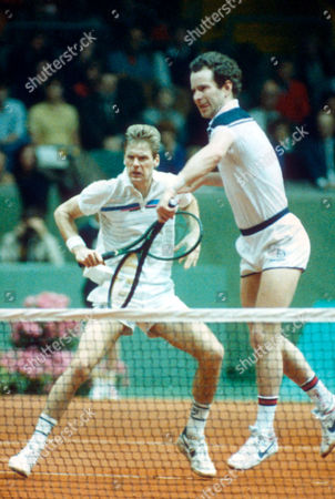 McEnroe Fleming John McEnroe, right, of the United States National Davis Cup team returns the ball, with doubles partner Peter Fleming in background, against Sweden's Anders Jarryd and Stefan Edberg in the men's doubles tournament in Gothenburg, Sweden, . McEnroe and Fleming were defeated. Sweden went on to win the title
