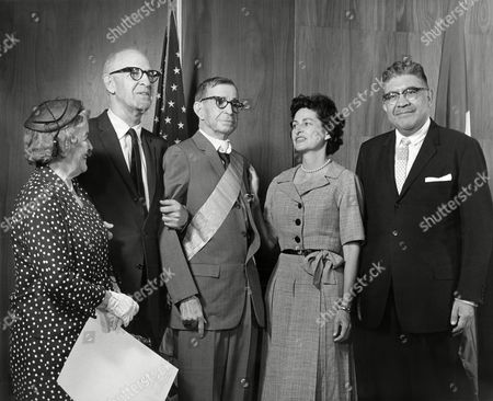 Dennis Chavez Mexican Ambassador Antonio Carrillo Flores presents to Senator Dennis Chavez, Democrat of New Mexico, the First Class Ribbon Insignia of the order of the Mexican Aztec Eagle in behalf of President Adolfo Mateos Lopez of Mexico during ceremony on . Left to right: Mrs. Dennis Chavez, Senator Lister Hill, Democrat of Alabama, Senator Chavez, Mrs. Lyndon B. Johnson, and Ambassador Carrillo Flores. Location unknown