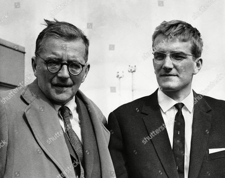 Dmitri Shostakovich, left, the renowned Russian composer, and his 22-year-old son, Maxim, a pianist arrive at London Airport on from Moscow