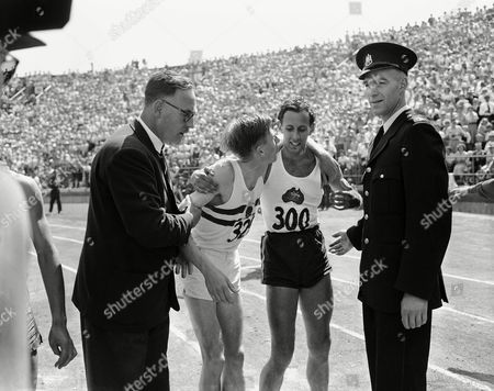 Roger Bannister, John Landy England?s Dr. Roger Bannister, left, puts arm around shoulder?s of Australia?s John Landy after the mile run in British Empire games at Vancouver, B.C. on . Bannister won race in 3:58.8 while Landy finished second with a 3:59.6 clocking