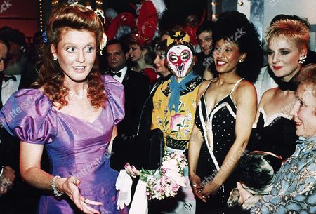 """Sarah Ferguson, the Duchess of York seems in quizzical mood as she meets actress Gretchen Franklin, far right, star of the British TV soap opera """"Eastenders"""" and her dog at the Theatre Royal, London, after the Royal Variety performance, a charity gala. Franklin had been taking part in the gala and other cast members are seen looking on"""