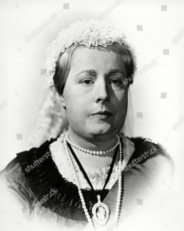 """Actress Irene Dunne is seen in her role as Queen Victoria in the British motion picture production """"The Mudlark,"""", in London, England"""