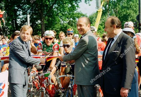 Stock Picture of Eberhard Diepgen, Jacques Chiraq, Jonathan Boyer, Teun Van Vliet Berlin Mayor Eberhard Diepgen, left, joins French Prime Minister Jacques Chiraq to give the official start of the 74th Tour de France in Berlin on . The riders at center are Jonathan Boyer of the U.S.A., left, and Teun Van Vliet of the Netherlands