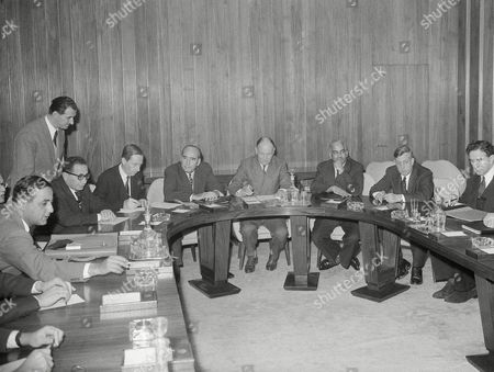 Representatives of the Egyptian government and of the old Suez Canal company shareholders began talks regarding compensation and other matters arising out of Egypt's nationalization of the Suez Canal in 1956 at the Rome, Italy, headquarters of the United Nations' FAO, . Delegates seated around the table as the conference opened. Clockwise are (from extreme left): Dr. Hassan Baghdadi of Egypt; Dr. Abdel Galeel El Emary, heading the Egyptian delegation; Carel de Beaufort of the Netherlands chief of the foreign George D. Woods, chairman of the first Boston Corporation of New York; William A.B. Iliff of Britain, vice president of the World Bank; P.S.N. Prasad, assistant economic director of the World Bank; Ellsworth Clark, World Bank counsel; John Foster, British legal advisor; and Charles Spofford, American Advisor. World Bank officials are acting as mediators at the talks