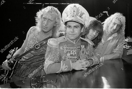 Stock Picture of Johnston Olsson Murray John British pop star Elton John, second from left, is seen at the rehearsal studios at Millwall in London's Dockland, with original members of his band. John and the band are slated to tour the U.K. for the first time in over five years. From left to right: Davey Johnston, guitar; John; Nigel Olsson, drums; and Dave Murray, bass