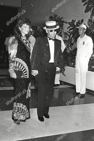 John Blauel British pop star Elton John arrives at the Monaco Sporting Club in Monaco with his wife Renate Blauel, to attend the annual Red Cross Gala in Monte Carlo