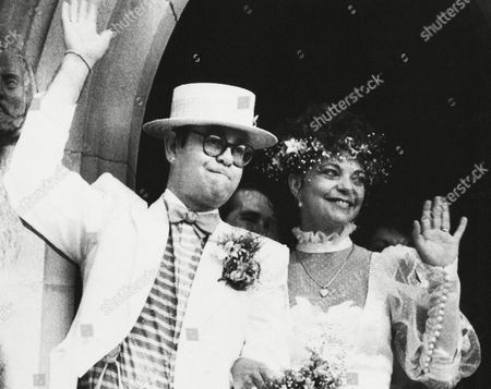 Watchf Associated Press International News Australia APHS57174 ELTON JOHN WEDS British rock star Elton John with his bride, Renate Blauel, wave upon leaving St. Mark's church in Sydney, Australia, Feb 14,1984