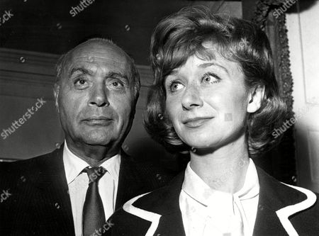 CHALES BOYER; JANE DOWNS French actor Charles Boyer, left, poses with British actress Jane Downs as he arrives in London, Great Britain, . Downs as wife, co-stars with Boyer as business tycoon, in the new Terrence Rattigan play 'Man and Boy' which starts later this month for an eight week run
