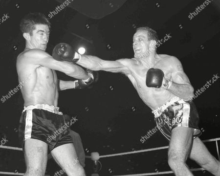 British Heavyweight Champion Henry Cooper, right, lands a hard right to the jaw of Roy Harris from Texas, during their fight at Empire Pool, Wembley, London, . Cooper won on a points verdict