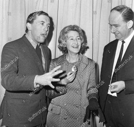Television personality David Frost, left, talks with Winifred Ewing, known as Winnie Ewing, a Scottish Nationalist Member of Parliament and Antony Jay during a luncheon hosted by Foyles Book store, held at the Dorchester Hotel in London, England on . The luncheon was held to mark the publication of To England with Love by David Frost and Antony Jay. Winnie Ewing was the chair of the luncheon