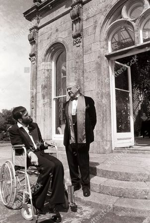 Stock Image of 'My Left Foot' - Christy Brown [Daniel Day Lewis] with Lord Castlewelland [Cyril Cusack].