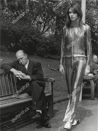 French singing star, Francoise Hardy, wearing a sensational metal trousers outfit, strolls through the Embankment Gardens in London, England, as an elderly man snores on a bench, taking a nap in the noonday sun, missing the stunning sight, . Later today Hardy will appear at the Cabaret at the Savoy Hotel here